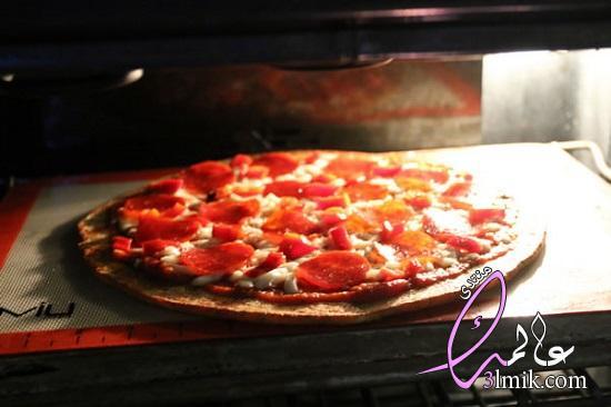 طريقة عمل البيتزا,عمل البيتزا,طريقة عمل البيتزا الايطالى,طريقه عمل البيتزا السريعه