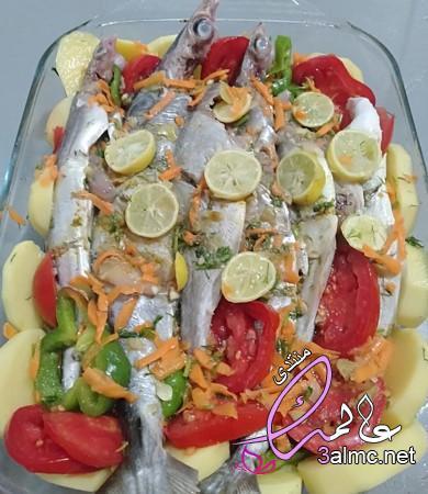 طريقة عمل صينية السمك بالبطاطس في الفرن بالصور من مطبخى